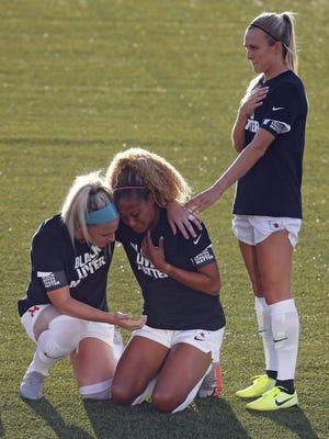 Chicago Red Stars' Julie Ertz holds Casey Short, center, while Rachel Hill lays her hand on her shoulder on Saturday in Herriman, Utah.