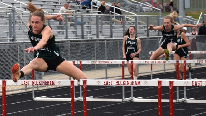 Wilson Memorial's Emilie Miller, left, leads sister Paige during the third heat of the girls 100-meter hurdles at a Shenandoah District track meet at East Rockingham High School in Elkton on Wednesday.