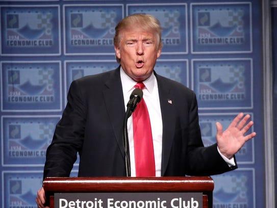 President Donald Trump addressing the Detroit Economic