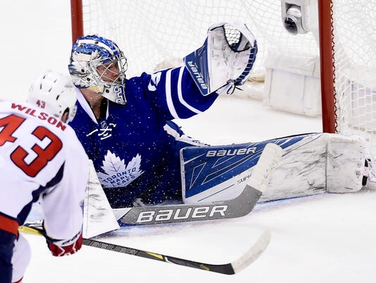 Washington Capitals right wing Tom Wilson (43) scores past Toronto Maple Leafs goalie Frederik Andersen (31) during first period NHL hockey round one playoff action in Toronto on Wednesday, April 19, 2017. (Nathan Denette/The Canadian Press via AP)