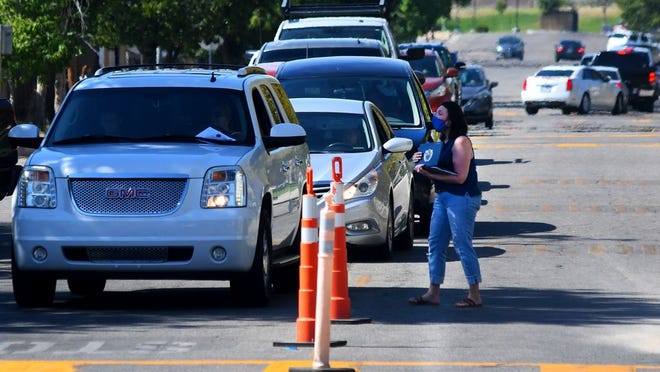 Car line up for blocks to get students registered at Taft Union High School Monday.