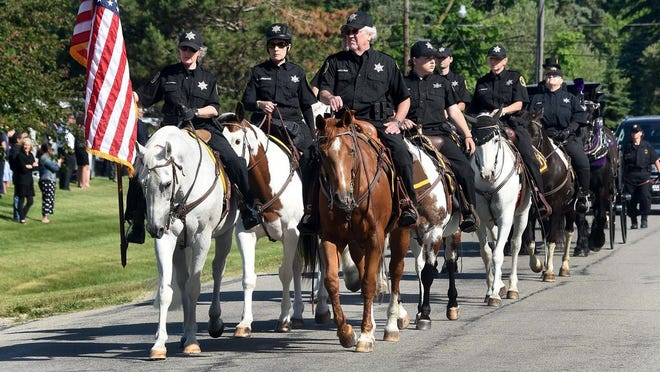 Monroe County Sheriff's Office Mounted Patrol took part in Darrian May Young's funeral procession.