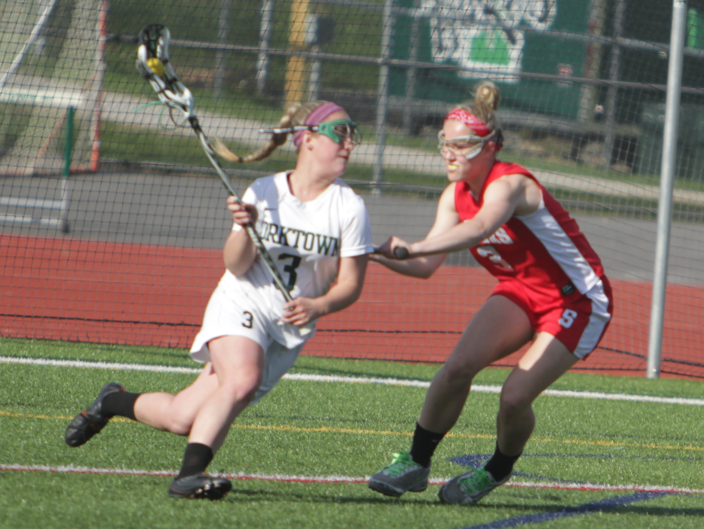 Action during a Section 1 girls lacrosse game between Yorktown and Somers at Yorktown High School on Thursday, April 21st, 2016. Somers won 11-10.