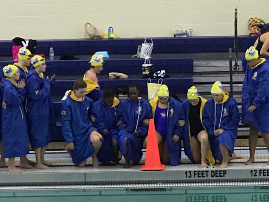 Some girls on the Irondequoit swim team knelt during