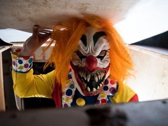 "Greg Durkin Jr. dons a clown costume at ""Land of Fear,"""