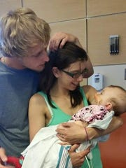 Kyle Prettyman, Alexa Shoultes and their daughter, Alana.