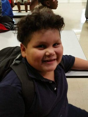 William Hernandez on his first day of second grade at Post-Franklin Elementary School. The student might not be able to attend Post-Franklin next year if Battle Creek Public Schools' restructuring proposal is approved by the school board.