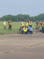 Emergency responders treat mock victims at Monroe Regional Airport. In the mock disaster, 13 victims died and 12 sustained injuries and were transferred to a local hospital.