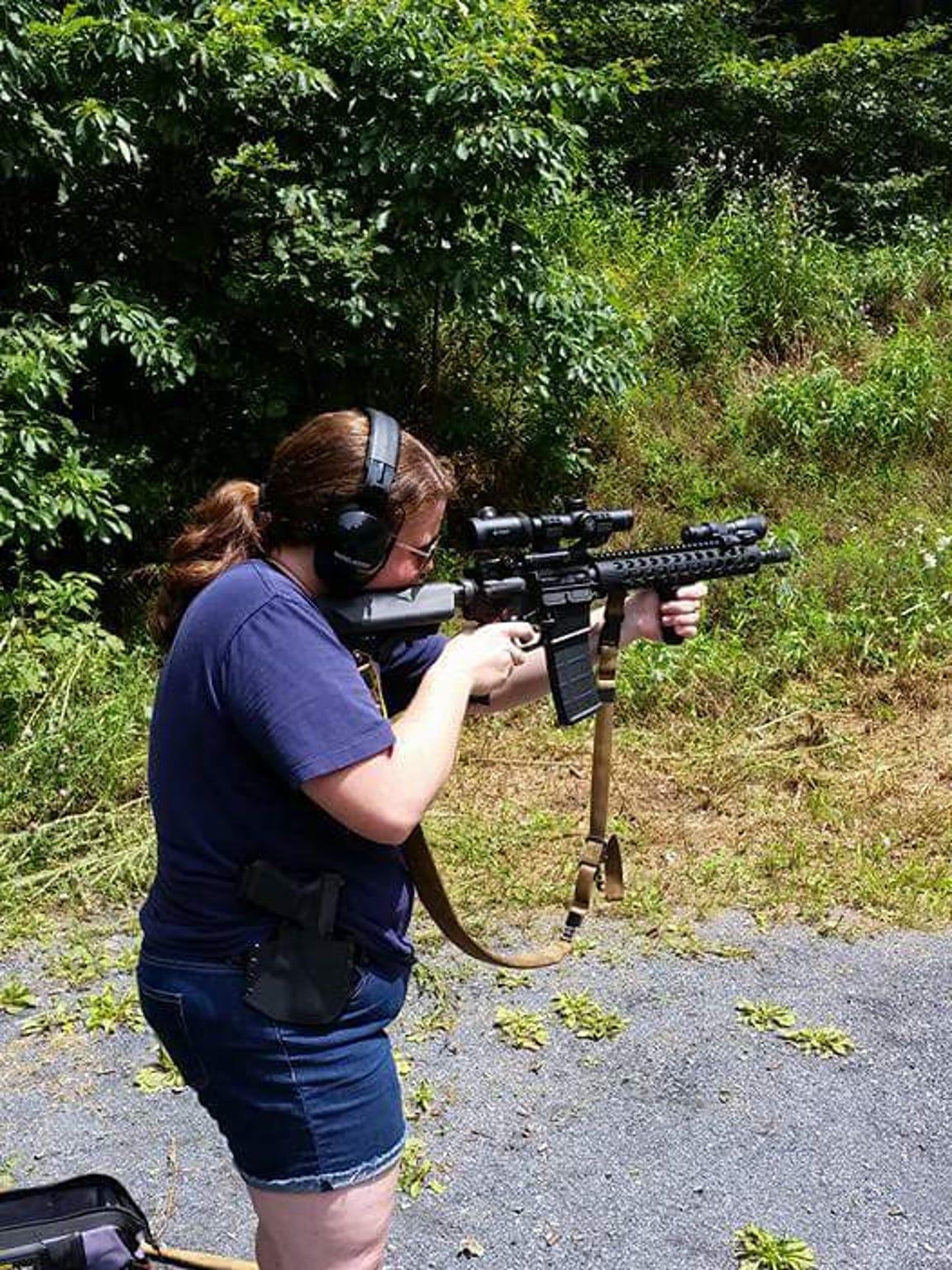 Sarah Thompson fires a .556 AR. She carries a Glock