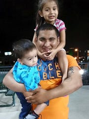 A picture shows Gilbert Sierra III with two of his children Alora Sierra and Gilbert Sierra.