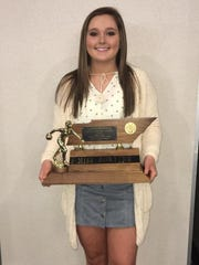 Hardin County junior Faith Welch poses with her TPBA