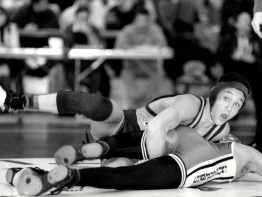 Damion Logan wrestling for St. Joseph Regional in the
