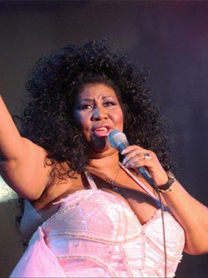 Aretha Franklin sings during a kick-off concert for