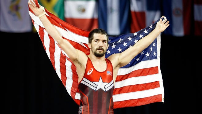 Brent Metcalf of the United States celebrates beating Franklin Maren of Cuba in the men's freestyle 65 kilogram finals during the 2015 Pan Am Games at Mississauga Sports Centre.