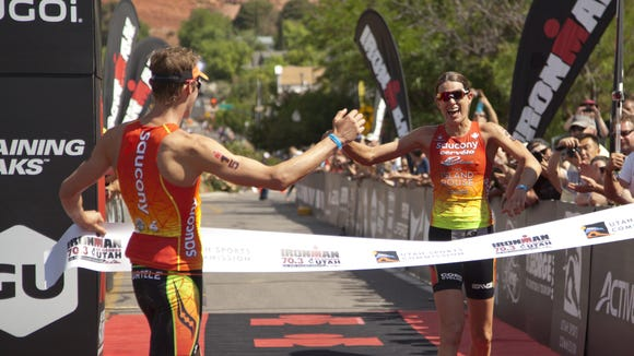 First female finisher Heather Wurtele crosses the finish line of the St. George Ironman Saturday, May 2, 2015.