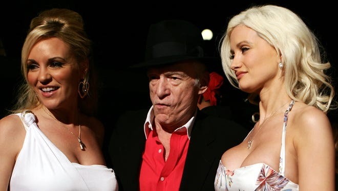 Hugh Hefner arrives at a party with his then-girlfriends Bridget Marquardt, left, and Holly Madison, to celebrate his 80th birthday in Rome.
