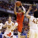 New Albany Bulldogs Romeo Langford (1) drives on McCutcheon Mavericks Billy Loft (42) in the second half of the IHSAA 4A Boys Basketball State Final game Saturday, Mar 26, 2016, evening at Bankers Life Fieldhouse. The New Albany Bulldogs  defeated the McCutcheon Mavericks 62-59.in the second half of the IHSAA 4A Boys Basketball State Final game Saturday, Mar 26, 2016, evening at Bankers Life Fieldhouse. The New Albany Bulldogs  defeated the McCutcheon Mavericks 62-59.