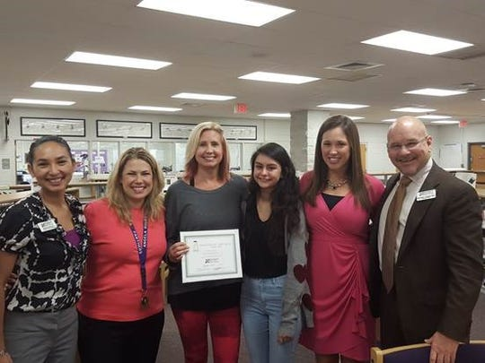 Jill Passarella, shown third from left, has been named the 2015-16 Take Stock in Children Mentor of the Year by the Foundation for Lee County Public Schools. Here, she poses for a photo after the announcement with, from left, Sheryl Verhulst, Angela Roles, Erica Hoffman, Alicia Miller and foundation CEO Marshall Bower.