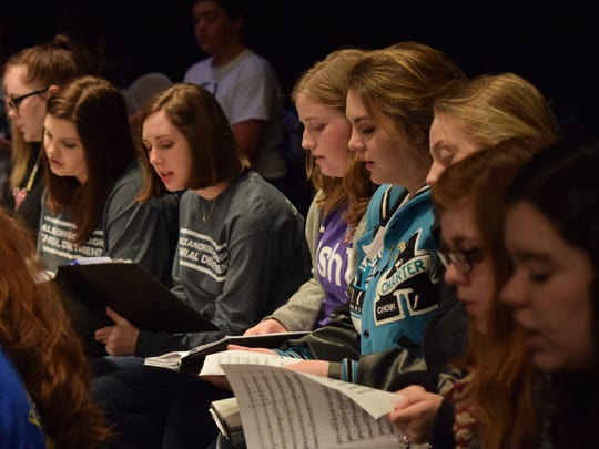 Honor choir students rehearse Friday afternoon at Pineville High School. District II Vocal Music Teachers Association will hold their annual honor choir festival this weekend, including a free concert at 11 a.m. Saturday at the high school.