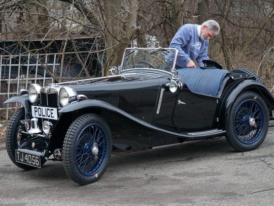 Rich Ruehle inspects the 1934 MG in the daylight on Monday before it is shipped to Florida.