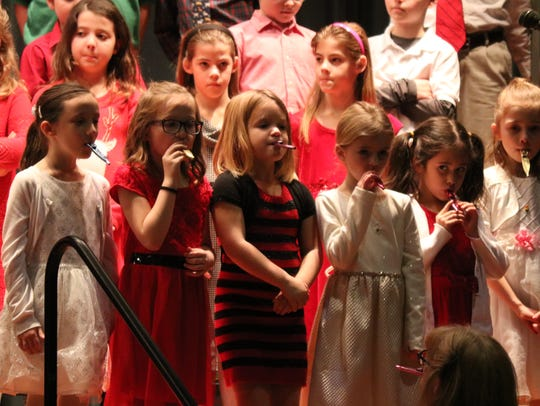 "Singing everything from traditional to parody songs, the ICS students entertained the crowd during the school's annual ""Traditions of Christmas"" concert."