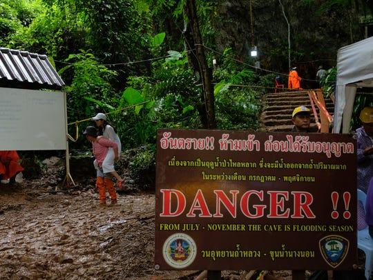 Warning signs of flood season at the entrance.