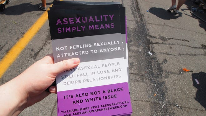 Fliers handed out a pride parade in Toronto explained the meaning of asexuality.