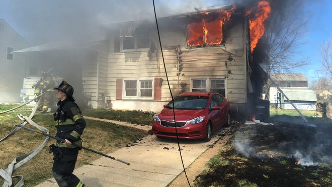 The flames were so hot from this fire in Elsmere, a neighboring home's siding was also damaged.
