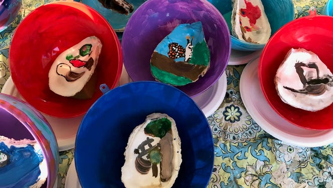 The painted oyster shells are glued to the other half of the shell and mounted inside brightly painted back halves of the clear globes that now hang on Maryland's tree along the Pathway of Peace surrounding the National Christmas Tree in Washington, D.C.
