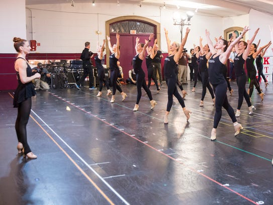"""Karen Keeler, director of Rockettes Creative, kicks off rehearsals for the 2017 """"Christmas Spectacular starring the Radio City Rockettes,"""" on Oct. 12 at St. Paul the Apostle Church. Here, she watches as the precision dancers present their tap number, """"The Twelve Days of Christmas."""""""