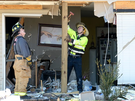 Battalion Chief Brian Black, left, measures space for