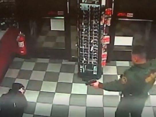 Surveillance camera footage shows a Border Patrol agent