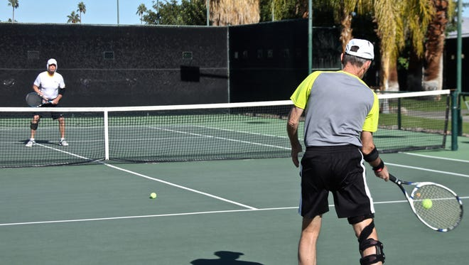 Members play tennis at Plaza Racquet Club.