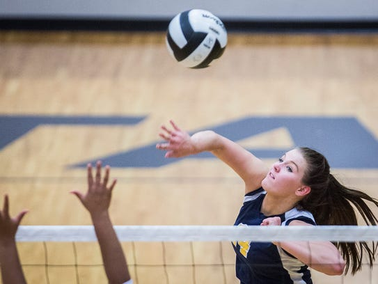 Delta's Emily Bechdolt hits past Central's defense