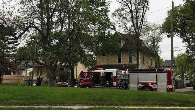 Lafayette firefighters douse a fire in the 500 block of South 10th Street Thursday afternoon.