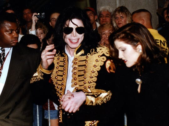 "Michael Jackson and Lisa Marie Presley leave sky box seats in The Pyramid just before the conclusion of  ""Elvis Aaron Presley: The Tribute, ""  Saturday, October 8, 1994."