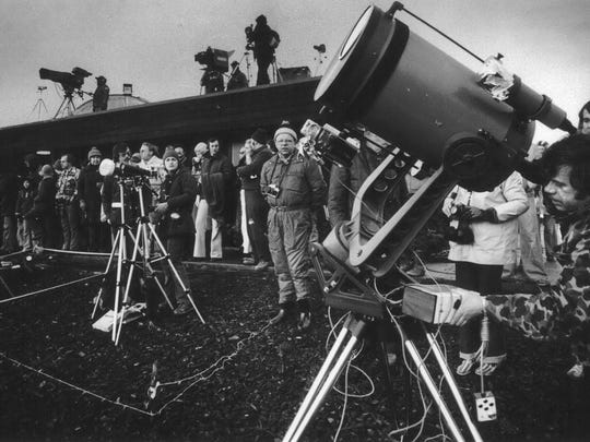 On Feb. 26, 1979, eclipse enthusiasts, photographers and television crews gather to watch the solar eclipse in Goldendale, Wash. The first place to experience total darkness as the moon passes between the sun and the Earth will be in Oregon and Madras, in the central part of the state, is expected to be a prime viewing location. Up to 1 million people are expected in Oregon for the first coast-to-coast total solar eclipse in 99 years Aug. 21, 20127, and up to 100,000 could show up in Madras and surrounding Jefferson County. Officials are worried about the ability of the rural area to host so many visitors and are concerned about the danger of wildfire from so many people camping on public lands. (Randy Wood/The Oregonian via AP)