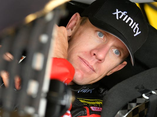 NASCAR Sprint Cup Series driver Carl Edwards looks out of his race car while waiting for auto racing practice to start at Kansas Speedway in Kansas City, Kan., Friday, Oct. 14, 2016. (AP Photo/Ed Zurga)
