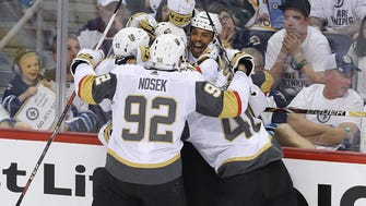 Ryan Reaves celebrates his goal with his Vegas Golden Knight teammates.