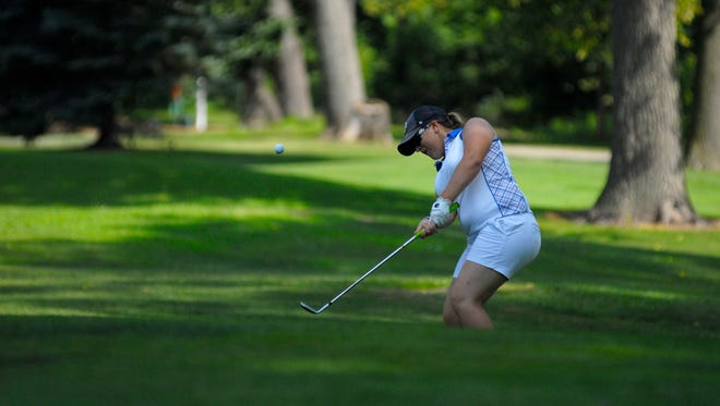 Kara Likins chips onto the green Monday, Aug 1, during the Tournament of Champions at the Port Huron Elks Golf Course.