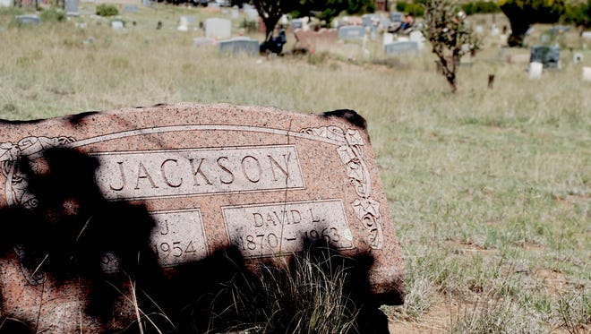 : The tombstone of David L. Jackson (1870-1963) and his wife, Mary J. Jackson (1869-1954) overlooks the cemetery that he was devoted to. The grave is located on the slope of the mountain. Many tombstones show historical names including first elected governor of NM, Gov. McDonald.