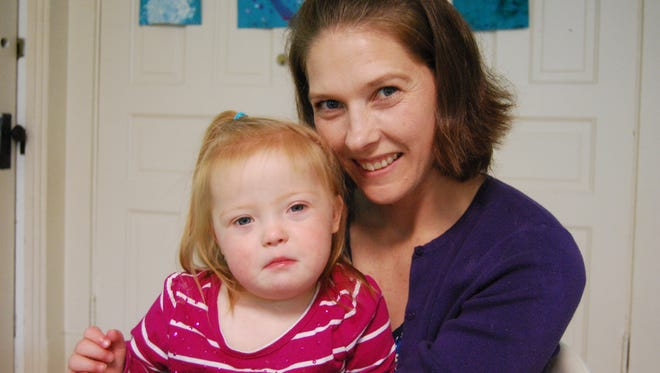 Nicole White, right, spends some time with her daughter Kate, 2, at St. John's Learning Center on Sept. 13, 2017. A picture of Kate will be featured in a video promoting Down syndrome awareness.