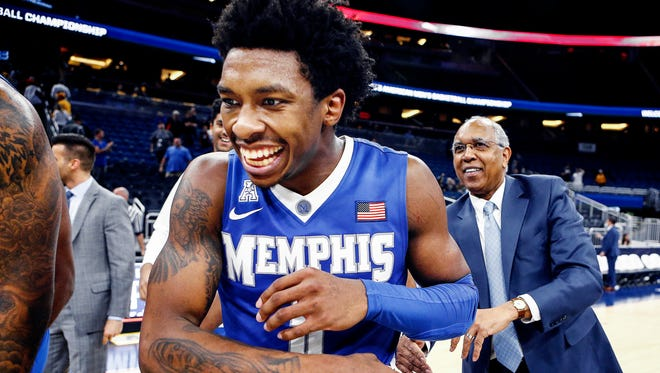 Memphis guard Kareem Brewton Jr. (left) is congratulated by head coach Tubby Smith (rihgt0 after a hitting a game-winning three pointer against Tulsa to advance to the AAC tournament semifinals in Orlando, Fl., Friday, March 9, 2018.