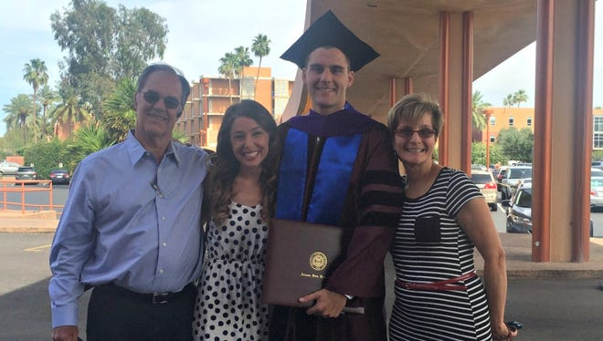 Kyle Orne poses during ASU graduation with his father, Jeff Orne; his wife, Natalie Orne; and his mother, Teri Orne.