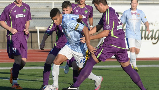 Luiz Petribu of the Shreveport Rafters edges his way through several Jesters to take a shot on goal in the first half.