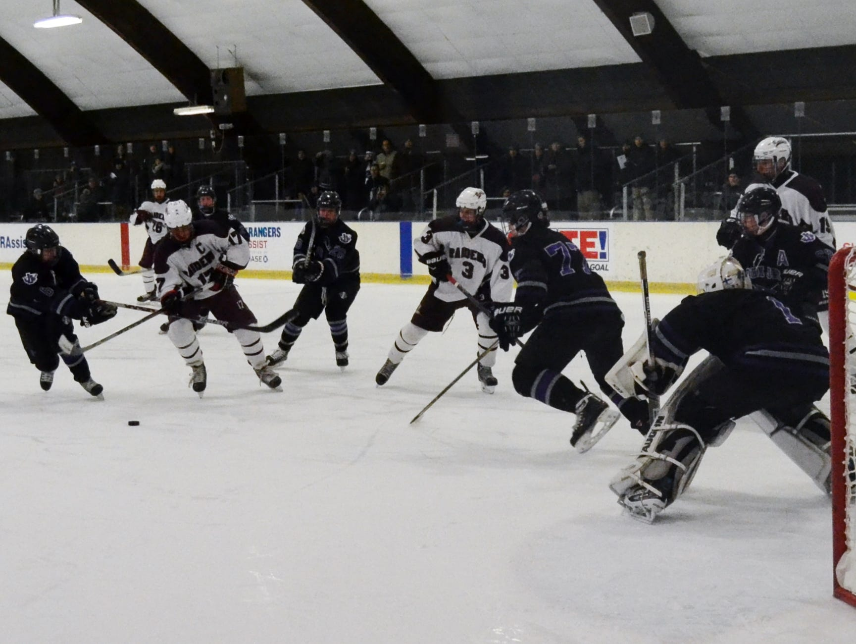 Scarsdale forward Stephen Nicholas makes a move to get inside the defense Friday at E.J. Murray Skating Center. He scored on the play and finished with a hat trick in the Raiders' 7-4 win over John Jay.