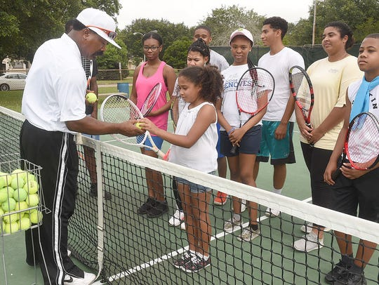 Rubin Simmons, OHS tennis coach teaches a tennis class