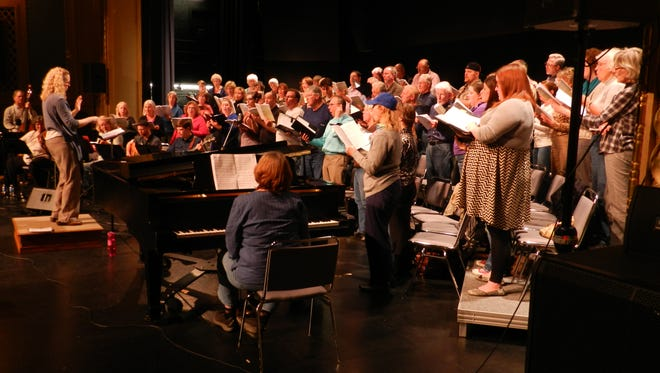 Minnesota Center Chorale and Monroe Crossing rehearse Tuesday for the bluegrass Mass collaboration.
