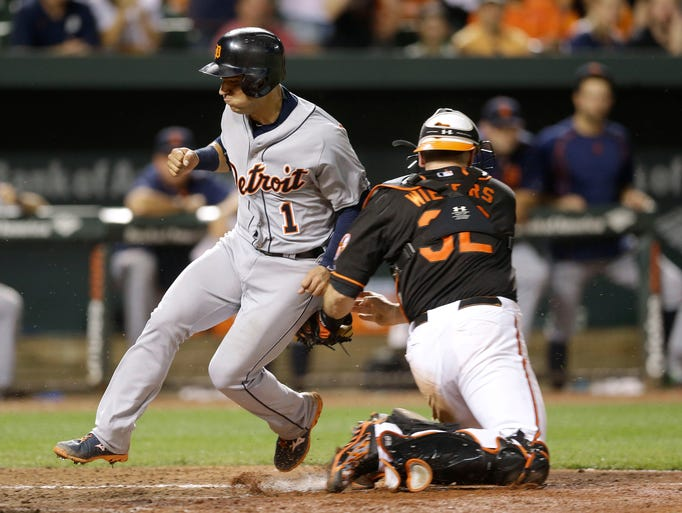 Detroit Tigers' Jose Iglesias, left, is tagged out