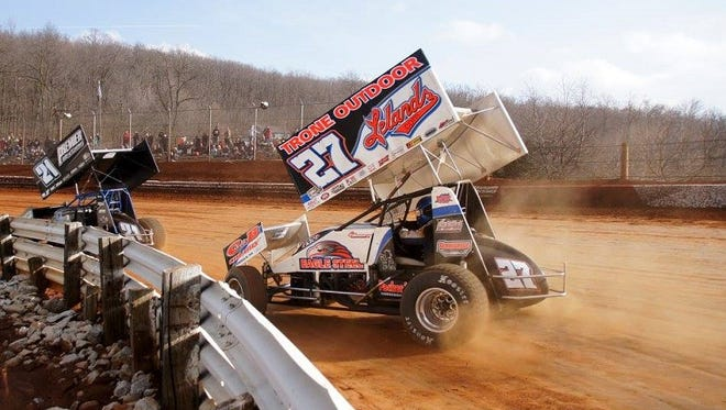 Greg Hodnett (27) tries to find a way to catch leader Brian Montieth during the 410 Sprint race at Lincoln Speedway on Sunday.